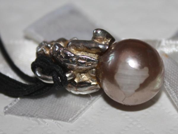 Beschädigte Perlenoberfläche
